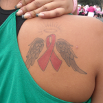 pink ribbon angel tattoo
